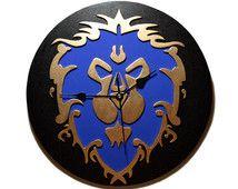 Reloj de pared con el simbolo de la Alianza de World of Warcraft. Wow, juego…
