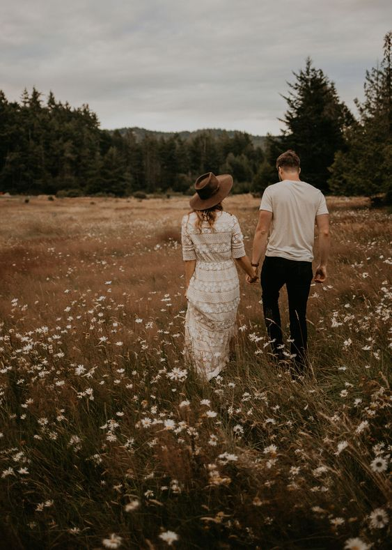beautiful romantic couple wandering floral fields