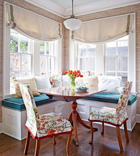 "Decor Refresh. ""In this breakfast nook, traditional style takes the helm. An antique table and chairs, re-covered in fresh slipcovers, showcase classical detailing. Banquette cushions in classic teal coordinate with the chair fabric. Neutral walls and windows, along with minimal accessories allow these few key elements to shine."" -BH:"