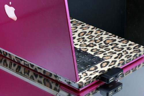 Pink and leopard Apple laptop