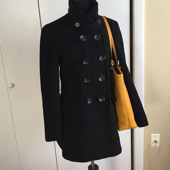 Calvin Klein Wool peacoat Like New black Calvin Klein winter coat. Shell 100% Wool , lining 100% polyester. Double breasted. Size 8 but runs smaller. I'm size 4 and fits me well, also will fit size 6. Calvin Klein Jackets & Coats Pea Coats