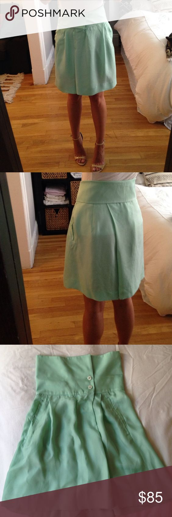 REISS Mint green silk pleated Skort These are actually shorts that are cut like a pleated a-line skirt. There is a zipper + button front enclosure, followed by 2 buttons above the waist that create an origami like fold when you fold it over. Measures 18inches in length from top button/fold to hem. No stains or tears- front pockets haven't even been opened! Reiss Shorts Skorts