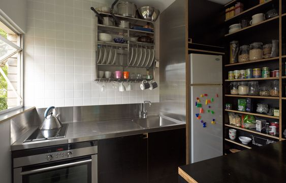 Inox surface black mdf open shelves