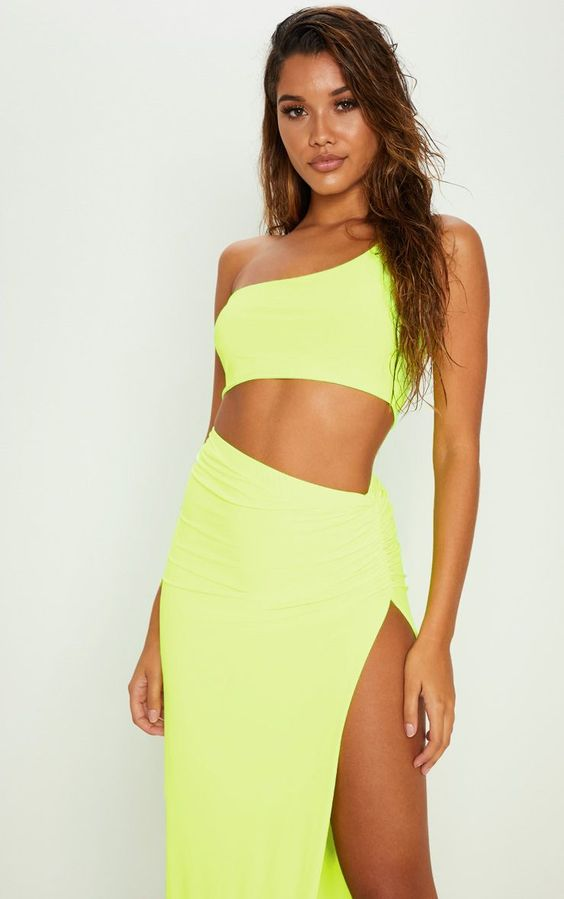 Neon Yellow One Shoulder Crop TopGirl be sure to be noticed in this ultimate must-have crop top. ...
