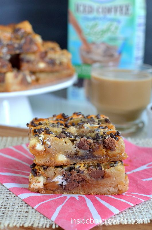 Caramel Macchiato Gooey Cake Bars - cake mix bars topped with caramel, white chocolate, chocolate chips, and a coffee sweetened condensed mi...