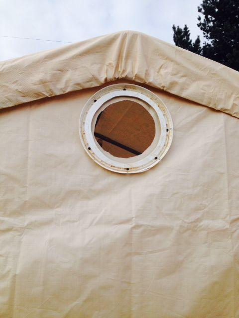 Ventilation window for carport chicken coop using a 5-gallon bucket lid and window screen.