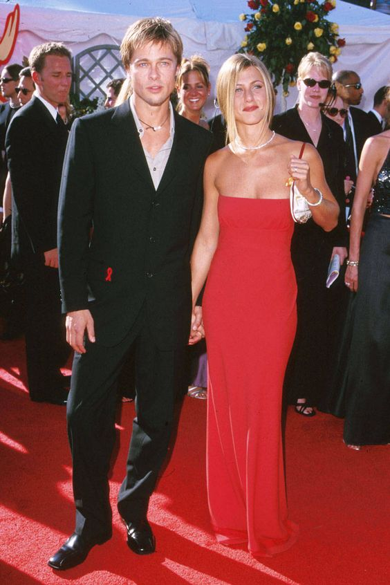 In Prada with her then husband Brad Pitt at the 52nd Annual Emmy Awards. - ELLE.com