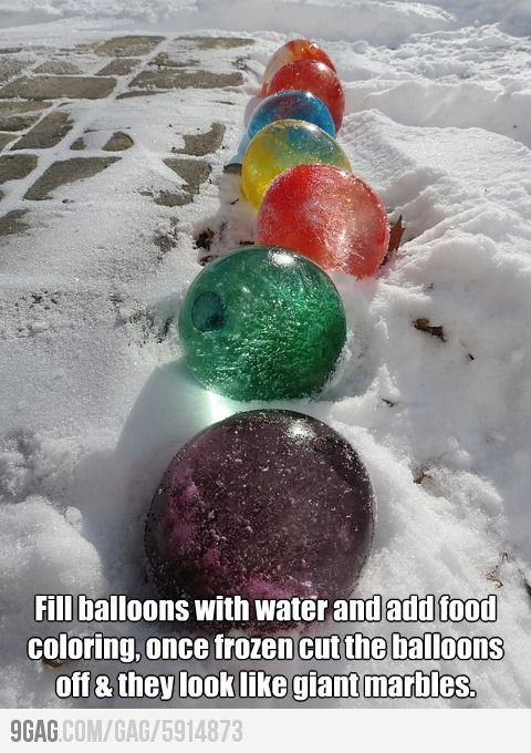 Awesome decoration idea aka what winter's great at! Fill balloons with water, add food coloring and line the sidewalk. When they're frozen, cut away the balloons.I'd want to marble-ize them somehow.