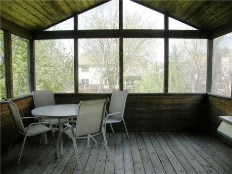 Upper level screened-in cedar porch with connector for gas grill