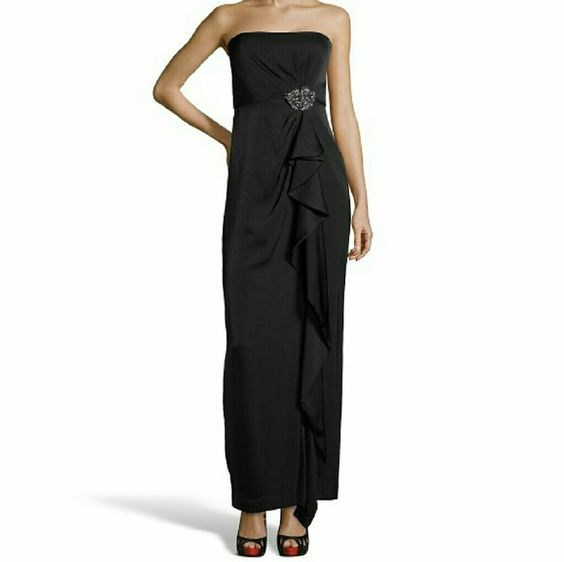 Navy BCBG Ila Gown Strapless With Non Slip Banding; Optional Spaghetti Straps IncludedBodice Features Internal Flexible BoningDraped Front With Removable Jewel Brooch At WaistConcealed Zip Closure At BackFully LinedContemporary FitSize 4 Measures Approximately 40'' Long From Natural Waist; May Vary By SizeHand Wash Or Dry CleanChina100% Polyester BCBG Dresses Strapless