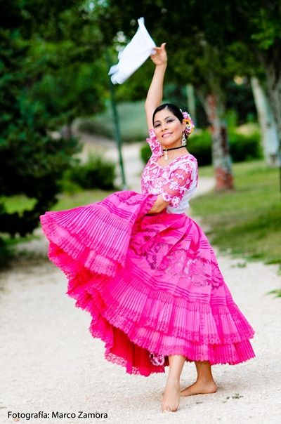 Traditional Peruvian courtship dance; woman in a pink dress
