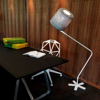 GROGGY floor lamp / Northern Lighting GROGGY is a small floor lamp with a big personality. Created by Tom Stepp as part of his Blueman collection the body and shade revolve making it easy to direct the light.