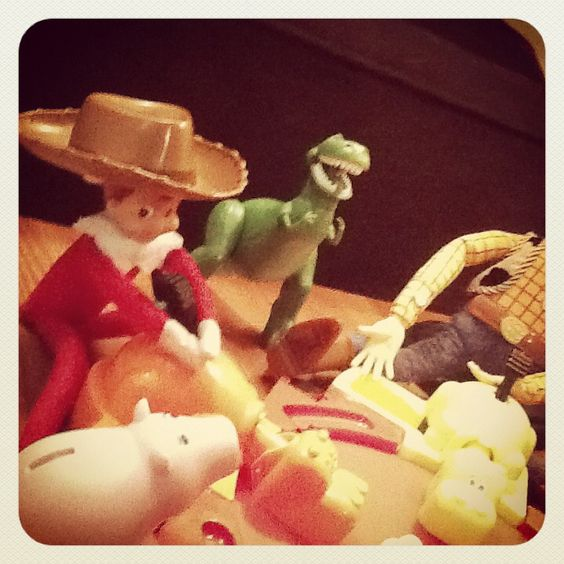 Wearing Woody's hat. Rex is amused.