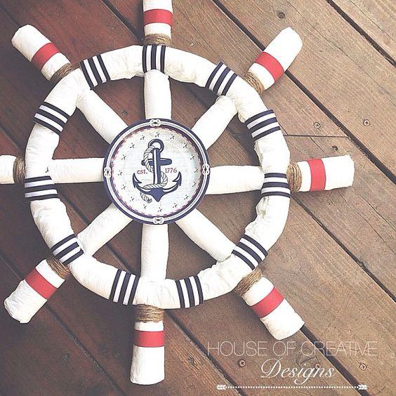 Nautical Diaper sculpture inspired by a ship wheel by House Of Creative Designs. Diaper Ship wheel, Diaper cake, Diaper wreath.