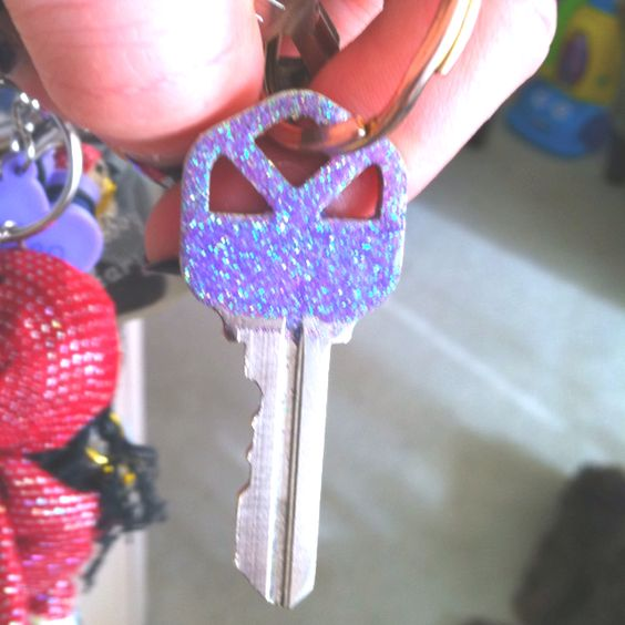 Easy way to recognize the key you want on your keychain. Put glue on the top of the key. Sprinkle whatever color glitter you want on top. Then add a few clear coats of nail polish on top.