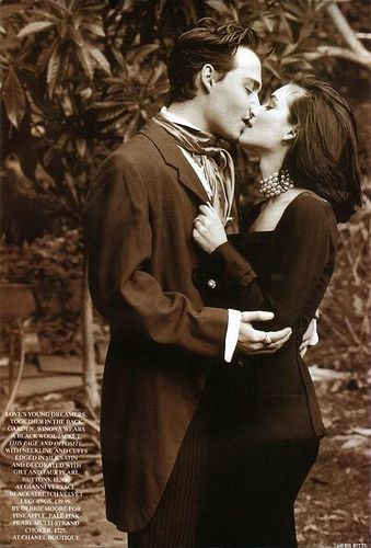 Johnny Depp & Winona Ryder. I love this photo. It's so romantic and old and of course do beautiful