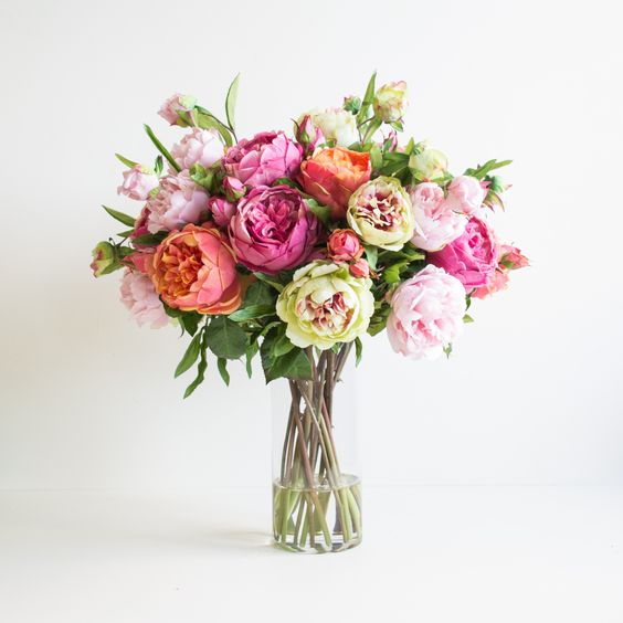 Spring has sprung. Artificial cabbage roses and peonies set in crystal clear resin water.