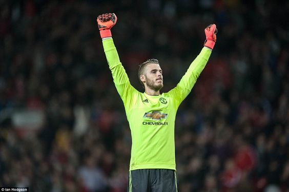 Manchester United goalkeeper David De Gea celebrates after helping his side earn a Champio...