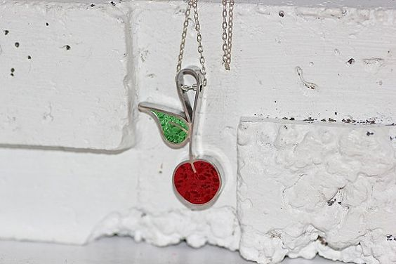 "Cherry Pendant  Sweet and juicy, a staple of the summer months...The cherry is said to be a symbol of the sweetness of character that is derived from good works. It has been referred to as ""the fruit of Paradise"" due to the belief that those who perform good deeds will one day arrive at this coveted destination....   $63.00"