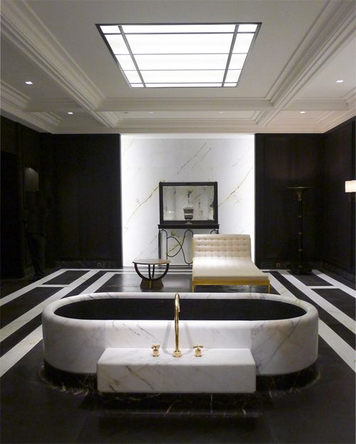 Superb bathroom done fully in black and white marble with a goregous marble tub surround!!  joseph dirand