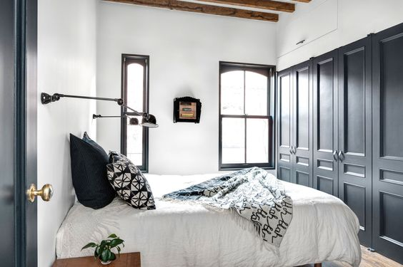 Bedroom with blue grey cabinets