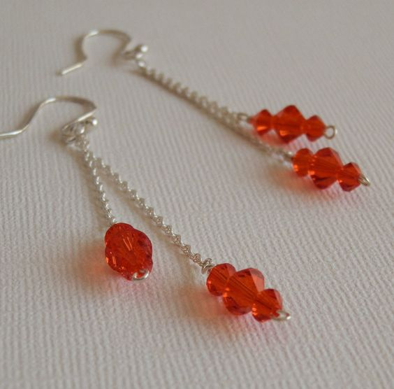 325 inch long orange crystal sterling silver by robynbirddesigns, via Etsy. This chain is super delicate and these were the hardest pair of earrings I have ever made, but I love the look
