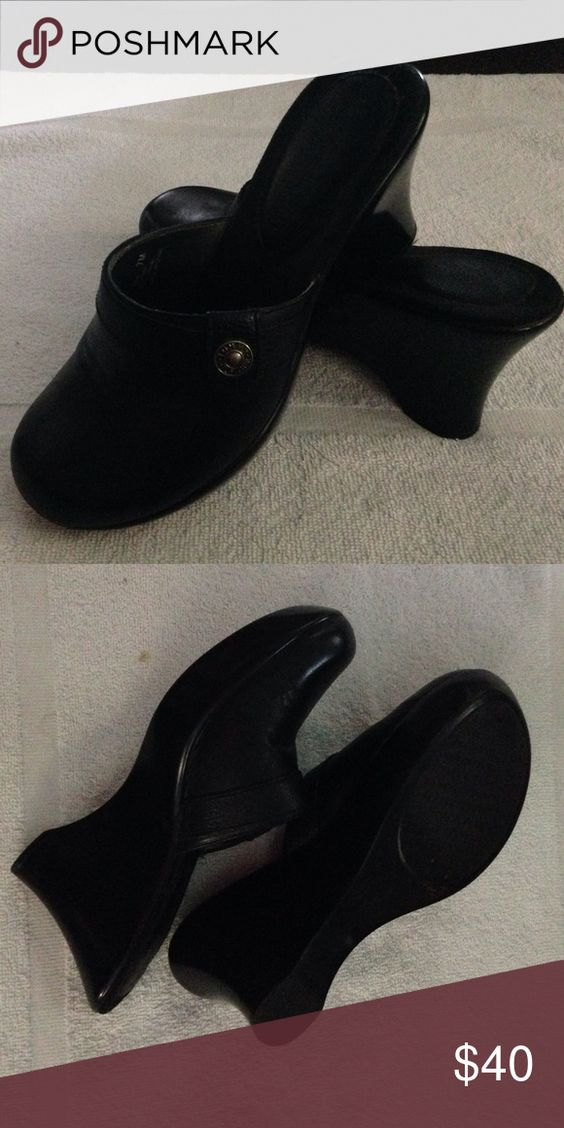 Tommy Hilfiger mule/clog wedge. 7M black Adorable mule, clog, wedge, everything shoe & in black. I tried to wear them once & am a 7W . So the 7M is true. Tommy Hilfiger Shoes Mules & Clogs