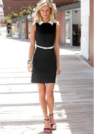 Black cotton dress. Narrow tailoring, Viennese seams front and back. Fashion detail: contrasting collar with gold applique. Golden zipper on the back. Length approx. 90 cm