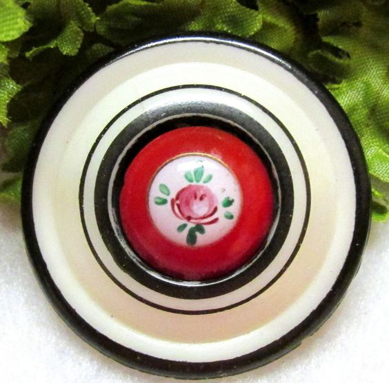 VICTORIAN MILK GLASS ESCUTCHEON BUTTON W/ BLACK RINGS RED CENTER W/ FLOWER