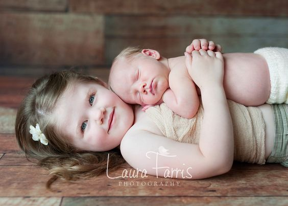This isn't my daughter but I have a pic just like this with her holding her brother....then she dropped him...lol