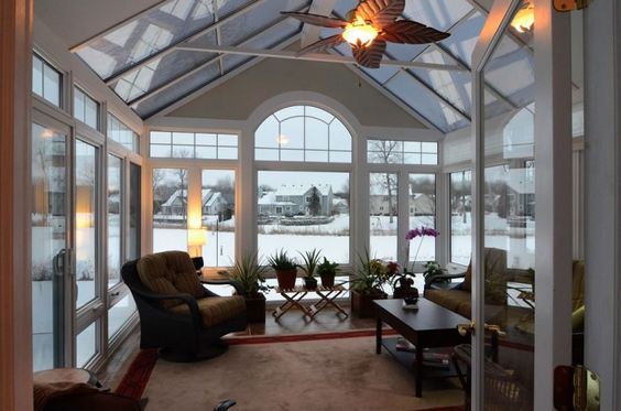 glass covered patio with high ceilings