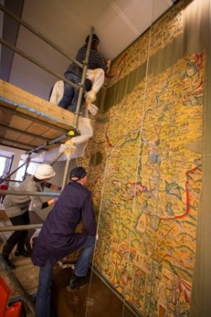 The map has finally come out into carefully filtered daylight, its colours glowing as if it was woven yesterday, after a gentle bath in Belgium and a year of tender hand stitching conservation work at the National Trust's textile workshop in Norfolk.  It will be exhibited in the Bodleian's renovated 1934 listed storage building, an important – if hideous – design by Giles Gilbert Scott. Intended to hold 5m books, and to solve the storage problem forever, it was judged 130% full by the time…
