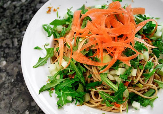 Sesame Noodles with Baby Greens and Peanut-Ginger Dressing. Yum yum yum...