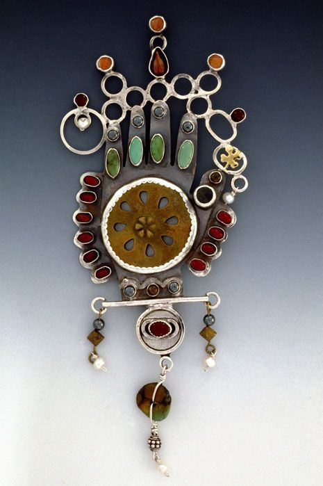 Brooch | Kristin Diener.   Sterling and fine silver, brass, found objects, grape seed, button, peach moonstone, carnelian, hematite, jasper, citrine, turquoise, pearl