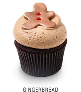 Georgetown Cupcake Gingerbread Cupcakes with Cinnamon Cream Cheese Frosting - the little gingerbread man is so cute!