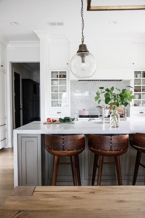 Wooden Counter Stools Sit At A Gray