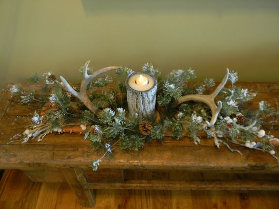 Made this winter table decoration with antlers and pine for Antler decoration ideas