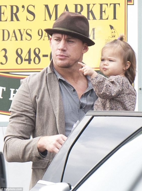 Family time: Channing Tatum looked dapper as he held baby Everly during an outing at the W...