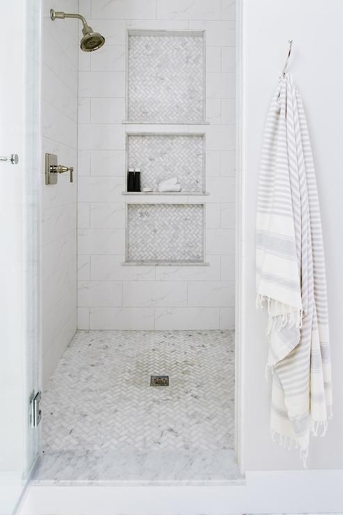 Walk In Shower With Triple Stacked Shower Niches And Marble Herringbone Pattern Floor Tiles Master Bathroom Shower Shower Remodel Shower Niche