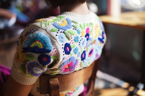 It looks like this is just a sweater that has been embroidered on. Way cool!: