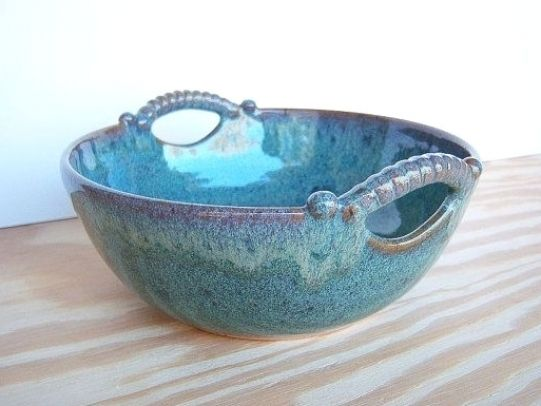 Hand made  painted pottery bowl with reed handle
