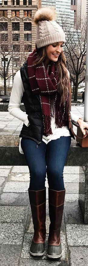 #winter #fashion / Grey Beanie / Red Scarf / Black Puff Vest / White Top / Navy Skinny Jeans / Black Boots