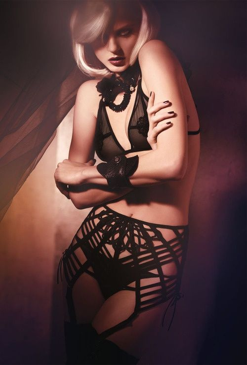 This strappy panty and garter belt set reminds us of a spiderweb. Perfect for Halloween lingerie!