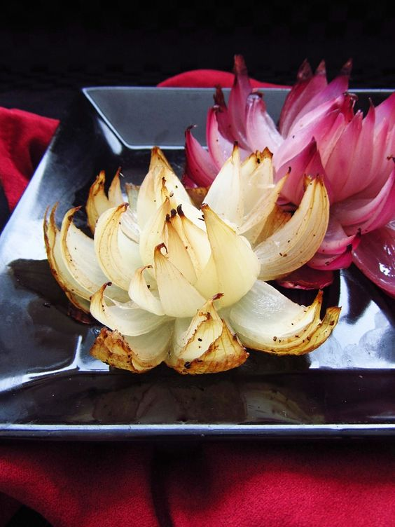 Onion Flowers -- so easy -- These flowers are made by simply slicing an onion into eighths, without cutting all the way through the onion so that it stays intact on the bottom, but the 'petals' fall down when baking to create a beautiful flower shape