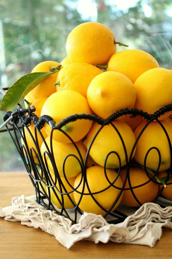 I love lemons piled in a wire basket-they get air circulation and inspire you to make all kinds of lovely things!: