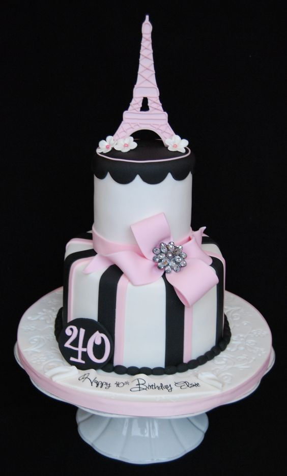 Eiffel tower 40th birthday cake - All fondant except for brooch in the center of the bow. pastel de quince