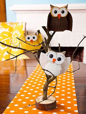 Owls made of cardboard tube and paper cupcake liners