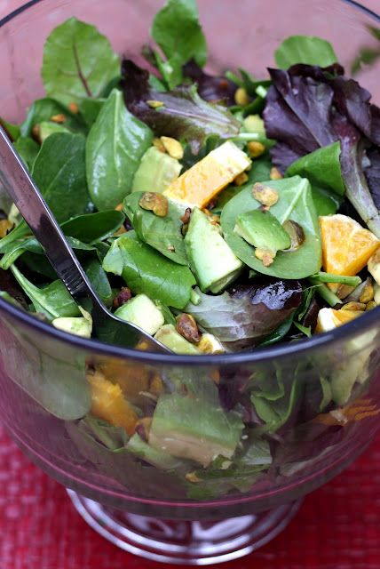 Honey-Orange Vinaigrette salad dressing with spinach leaves, orange chunks, avocado, and nuts.....
