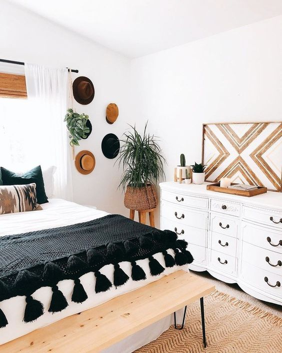 This bedroom pairs the cool combination of black and white with warm organic materials to create an ultra-chic and balanced design.
