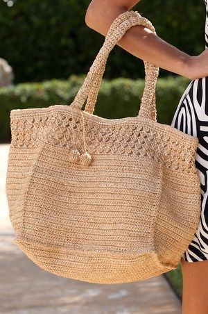 Fully-lined tote with convenient magnetic-snap closure and handy inside slit pockets.• Raffia straw.• Imported.• Natural.